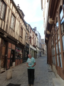 One of the many streets in Auxerre with houses made with timber framing. They are stunning as is the lovely man in front studying his map :)