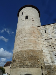 These crenelated walls and tower dated 1320 form part of the St Germain abbey. A windmill was built in the tower during the XVth century.