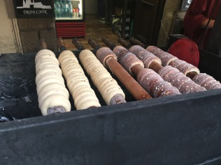 Trdelnik, delicious donut. Rolled onto a stick and cooked over hot coals before dunking in a walnut and sugar mix. Delicious!