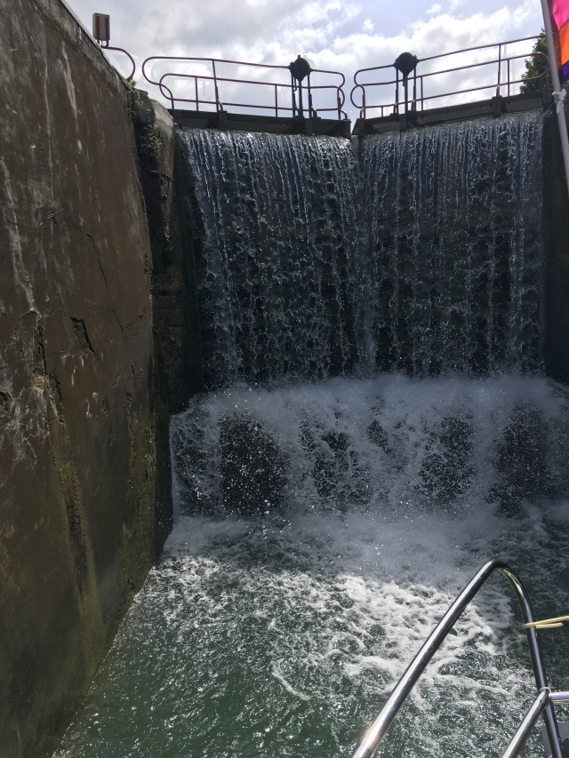 5 metre Migennes lock spilling water as we motor into it.