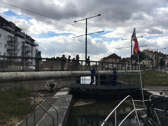 Passing through one of the locks in Dijon with some onlookers, two of them from Melbourne!