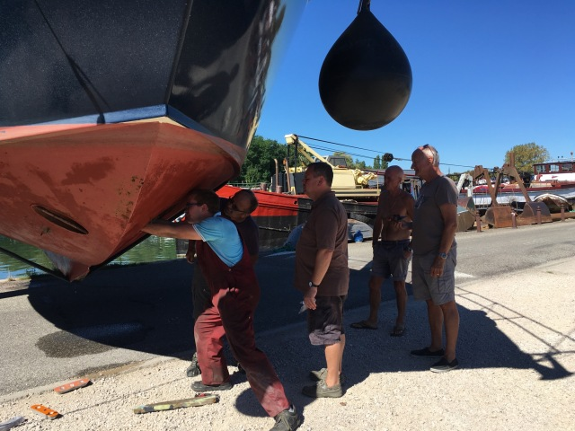 How many men does it take to change a bow thruster...