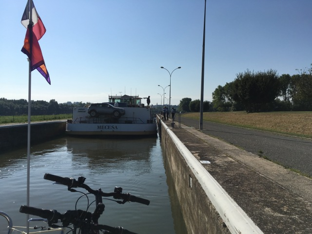 Gendarmes chatting to the Captaine of the commercial barge in front.